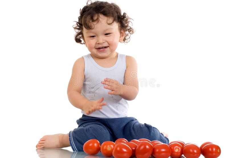 Child with tomato. stock photos