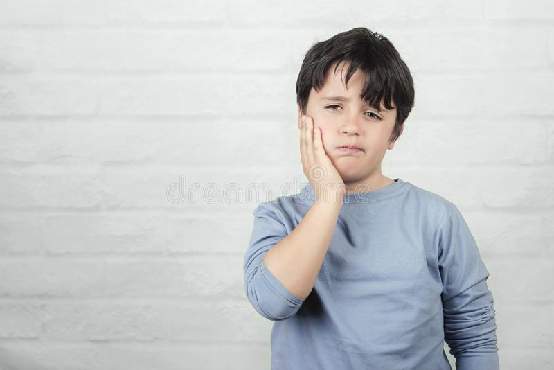 Child with toothache royalty free stock photography