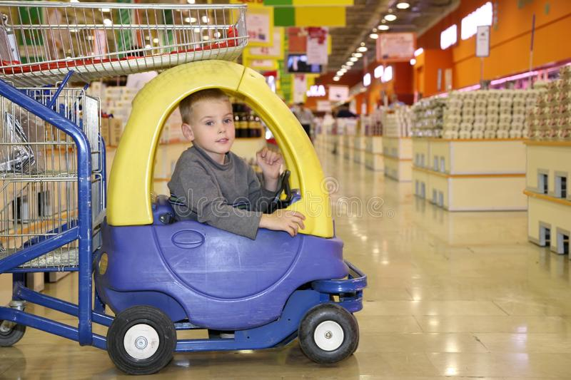 Child in the toy automobile royalty free stock image