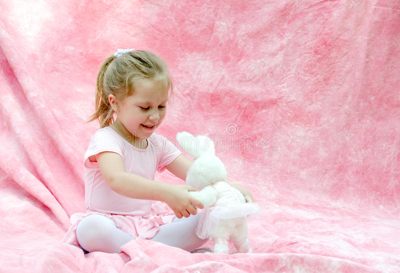 Child with toy ballerina bunny royalty free stock photo
