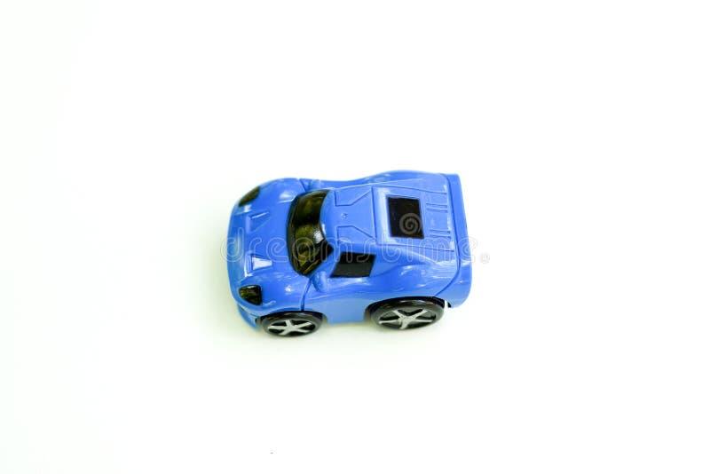 Child toy blue car isolated on white background. Childhood royalty free stock photos