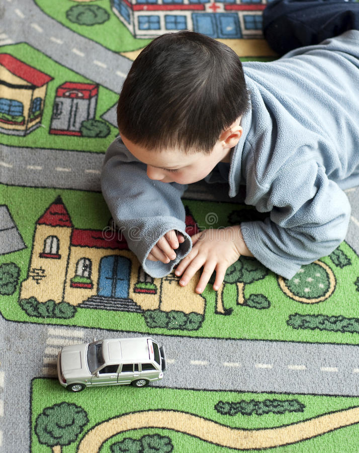 Download Child with toy car stock photo. Image of inside, playgroup - 23912552