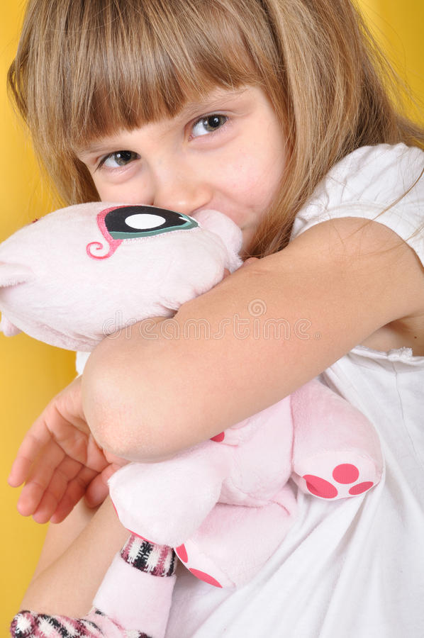 Download Child with a toy cat stock photo. Image of naughty, blond - 18848688