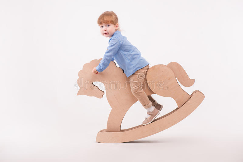 Child with the toy horse royalty free stock image