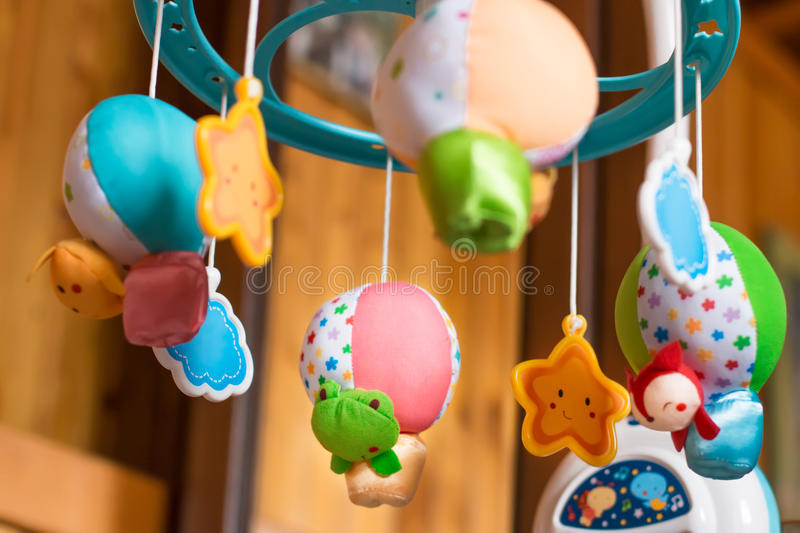 Child toy musical mobile air balloons with animals peeking out royalty free stock photos