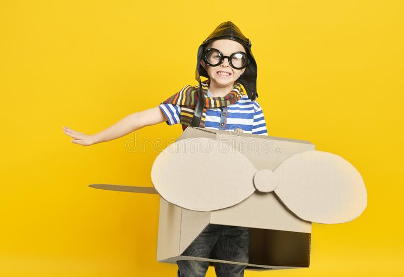Child in toy plane stock photos