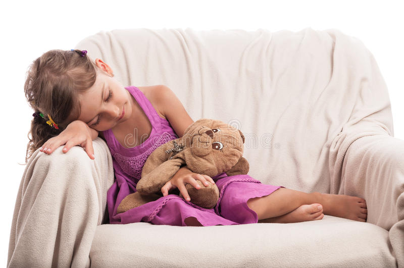 Child with toy taking nap