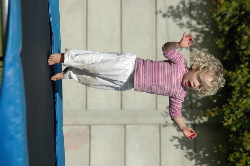 Child on trampoline royalty free stock images