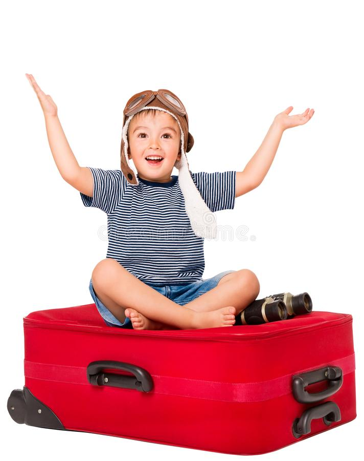 Child on Travel Suitcase, Kid in Pilot Hat Sitting on Luggage. Child on Travel Suitcase, Kid in Pilot Hat Sitting on Red Luggage, Happy Boy Open Arms Isolated stock images