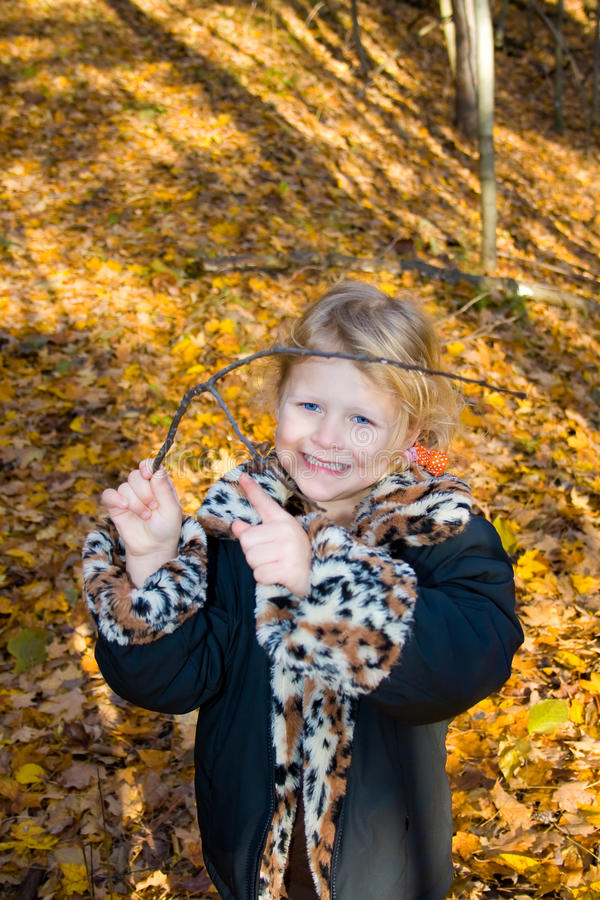 Child with a tree branch. royalty free stock images