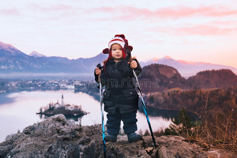 Child with trekking poles on Bled Lake, Slovenia, Europe stock images