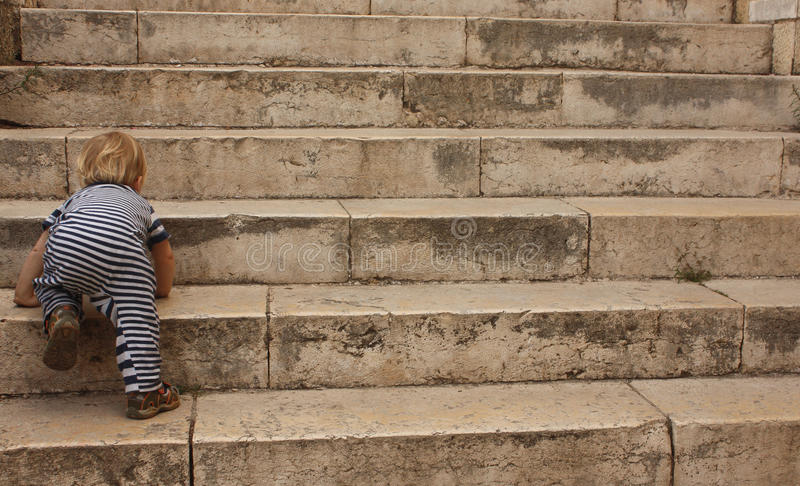 Download The Child Tries To Climb Back To Top Stock Photos - Image: 12691913