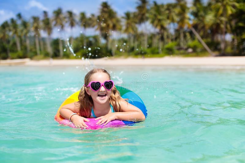 Child on tropical beach. Sea vacation with kids royalty free stock photography