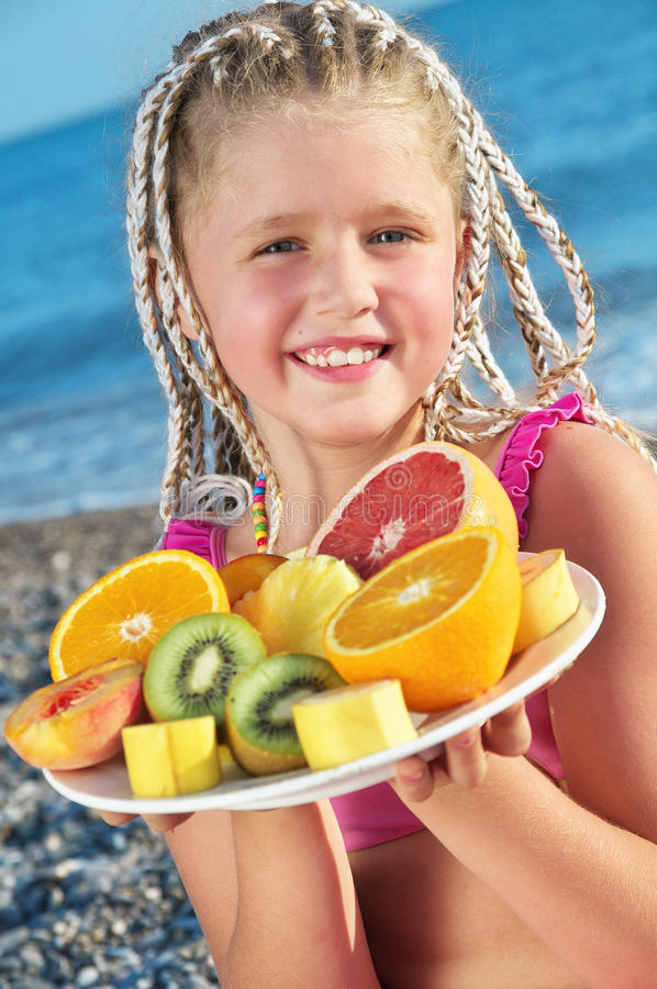 Download Child with tropical fruit stock photo. Image of food - 26114704