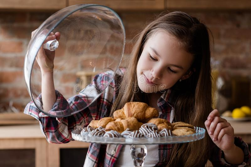 Child unbalanced eating habits sweets overeating. Child unbalanced eating. unhealthy bad habits. confectionery and puff pastry overeating. little girl drooling royalty free stock image