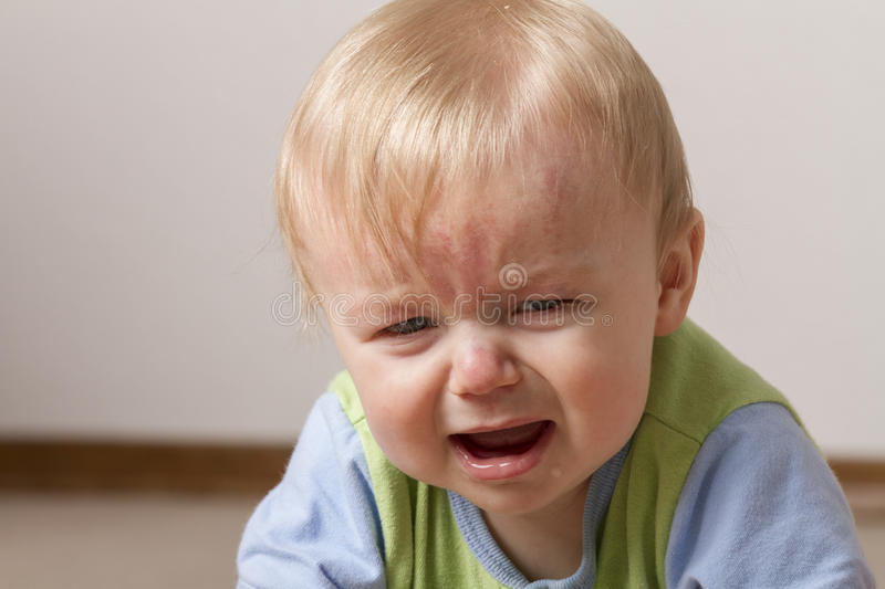 Child upset and not very happy stock photography