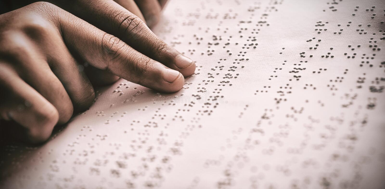 Child using braille to read stock photo