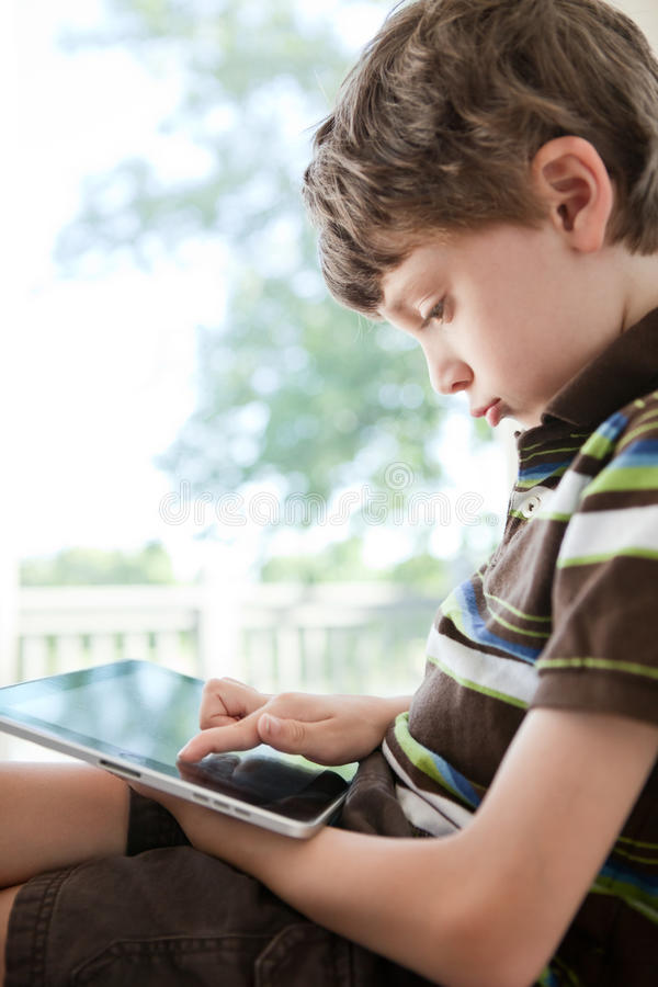 Download Child Using Tablet PC Stock Photos - Image: 22368043