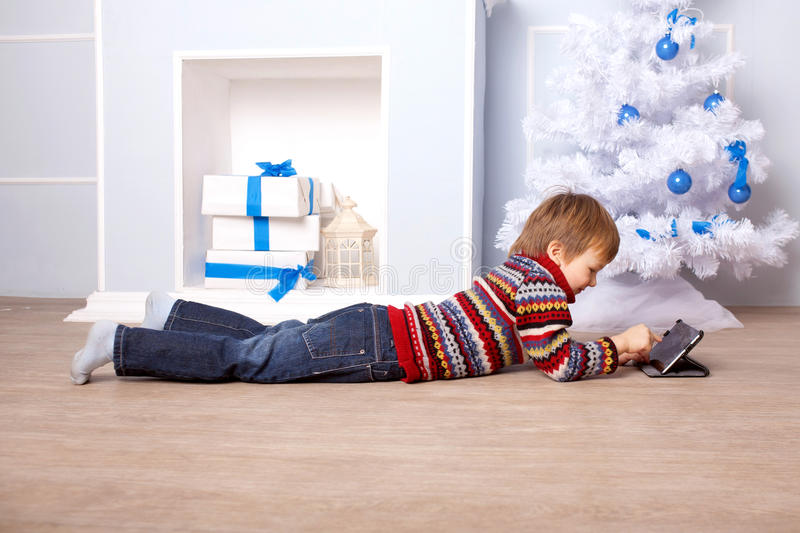 Child using tablet PC. Computer Generation concept. stock images
