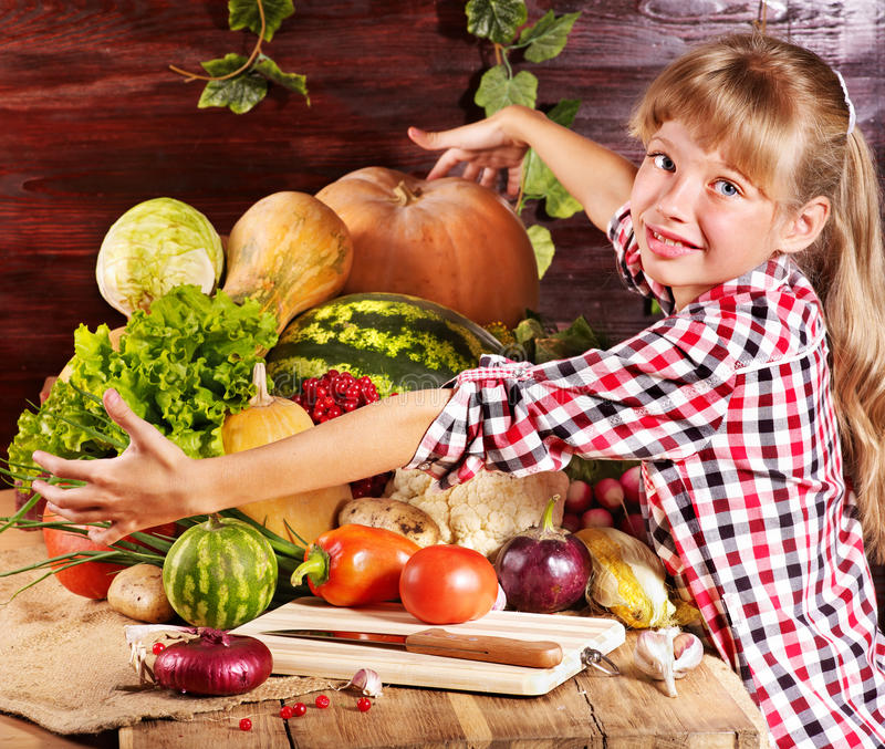 Download Child With Vegetable On Kitchen. Stock Image - Image: 21842353
