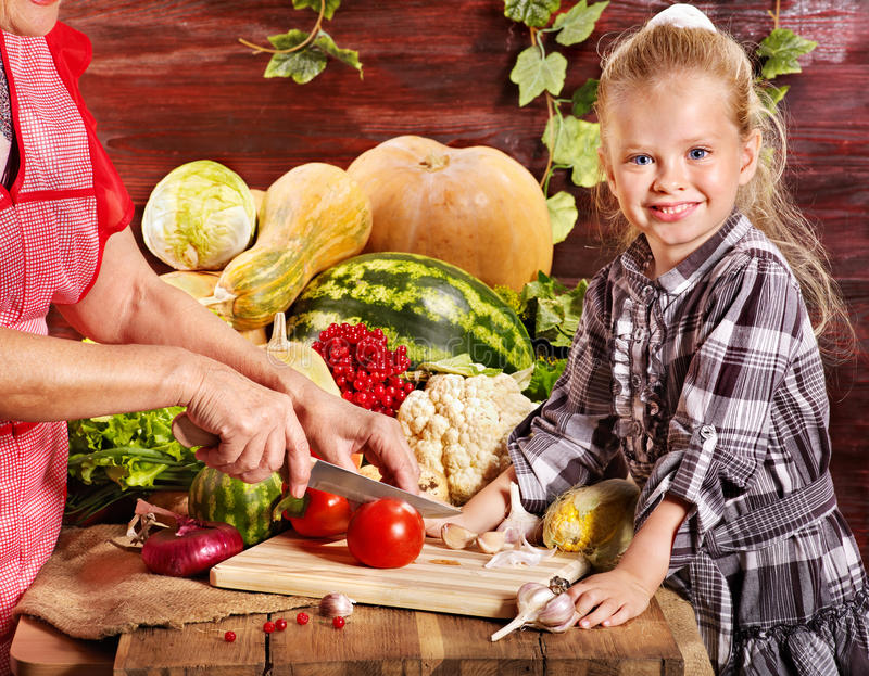 Child with vegetable on kitchen. royalty free stock images