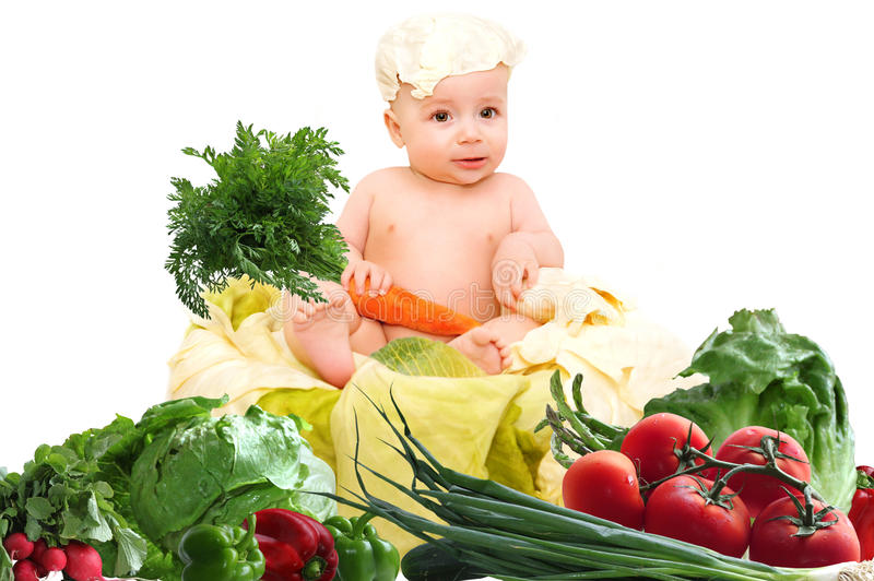 A child with vegetables on a white background stock photography