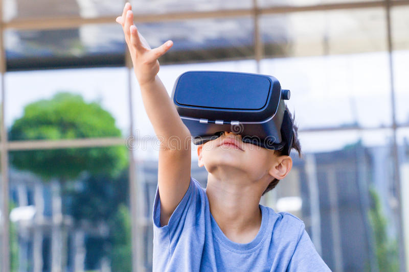 Child with virtual reality goggles in the city royalty free stock photography