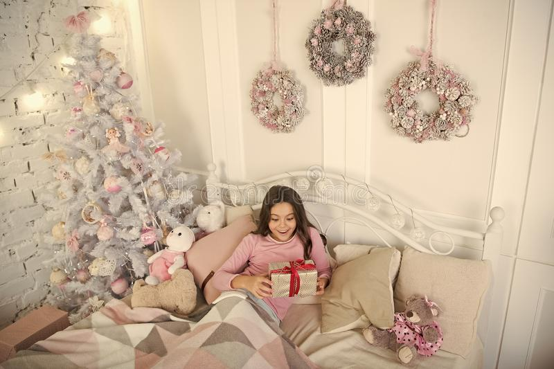 Child waiting christmas in bedroom. Kid lay in bed relaxing. Home is the best place in the world. Girl little kid royalty free stock photo