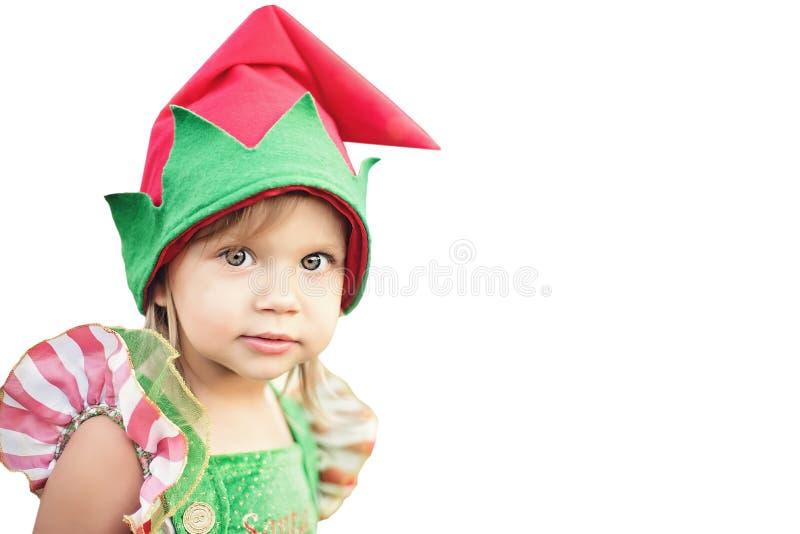 Child waiting for Christmas. portrait of little girl in christmas elf hat stock photo