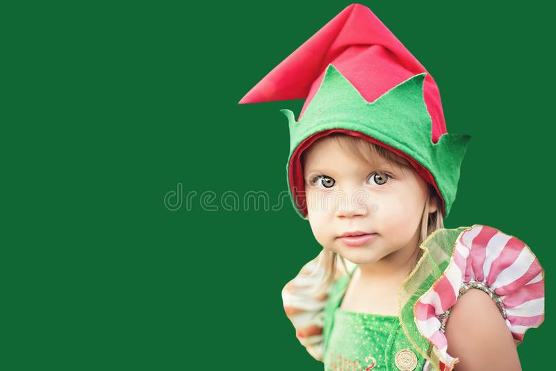 Child waiting for a Christmas in wood in juli. portrait of little children near christmas tree. girl decorating christmas tree stock photo