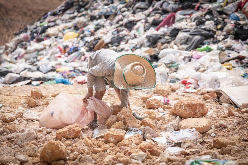 Child walk to find junk for sale and recycle them in landfills, the lives and lifestyles of the poor, The concept poverty, child. Labor and human trafficking stock photography