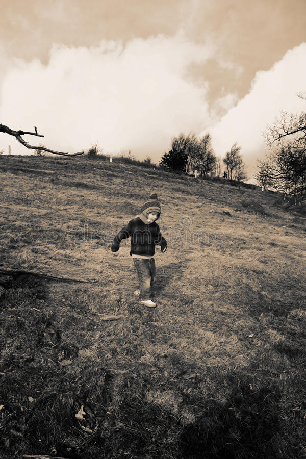 Child walking down hill stock photos