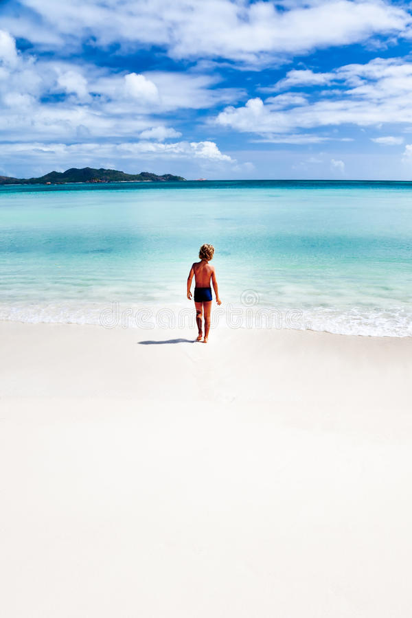 Download Child Walking On A Tropical Beach Stock Photo - Image of morning, standing: 16073452