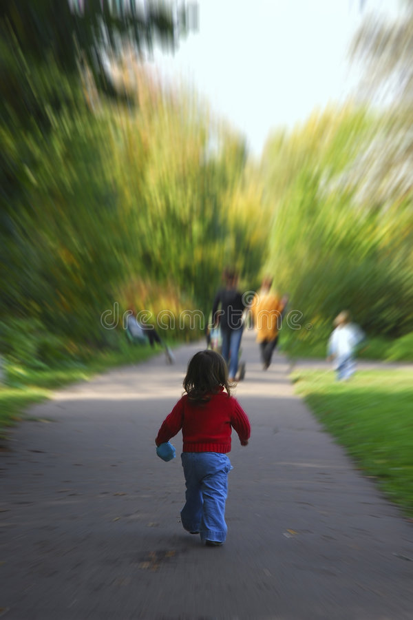 Child is walking at the wood stock image