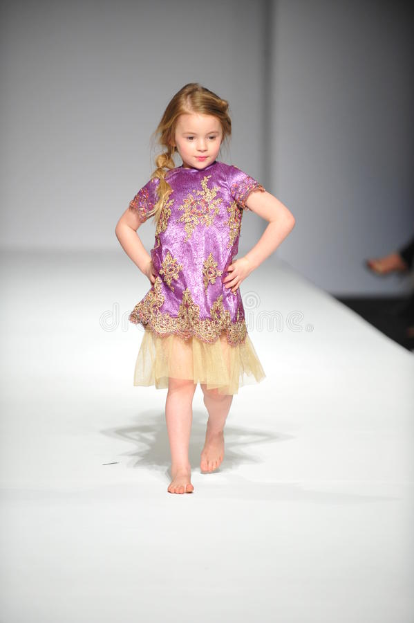 A Child Walks Runway At Nancy Vuu Children Show Editorial
