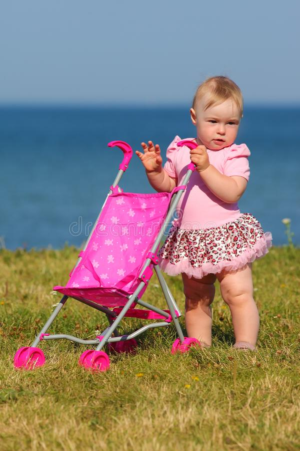 Child walks by the sea. Small child walks by the sea stock images