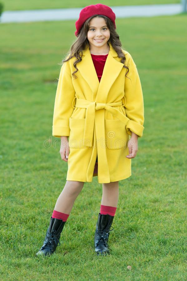 Child in warm clothes. Feeling cozy and comfortable. Fancy coat. Classic coat does not have to be boring but sticking to. Scale of warm, understated tones. Girl royalty free stock photos