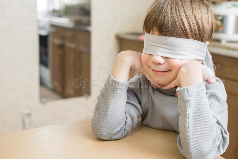 The child was blindfolded at home royalty free stock images