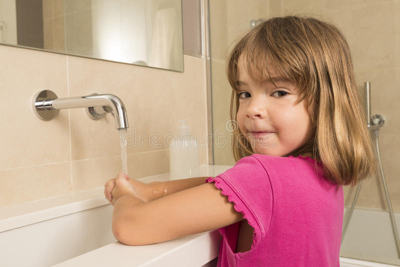 Child washing hands. Closeup of child washing hands under the tap royalty free stock photos