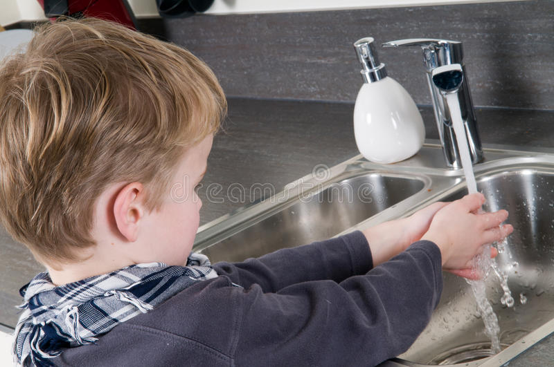 Child washing his hands royalty free stock image