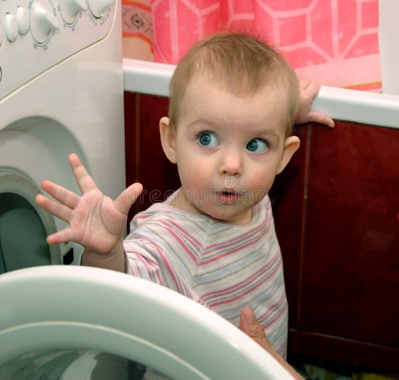 Child and washing machine stock photos