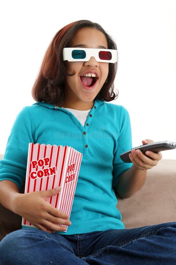 Child watching movie stock photo