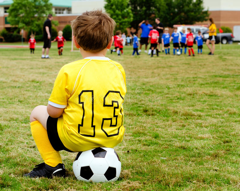 Download Child watching soccer game stock photo. Image of practice - 25665716