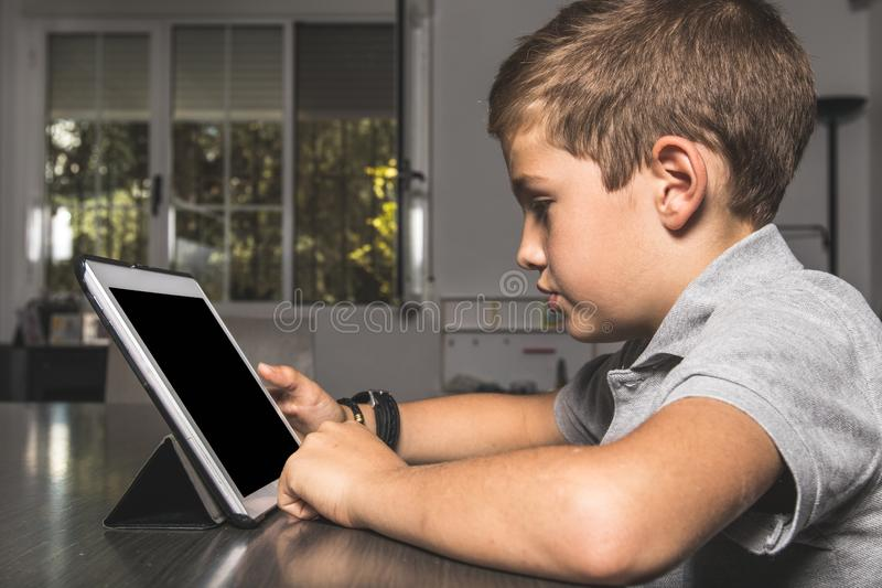 Child watching a tablet at home stock photos