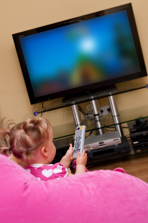 Child watching television stock photography