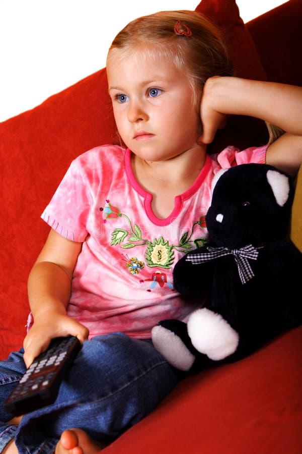 Child watching TV stock photo