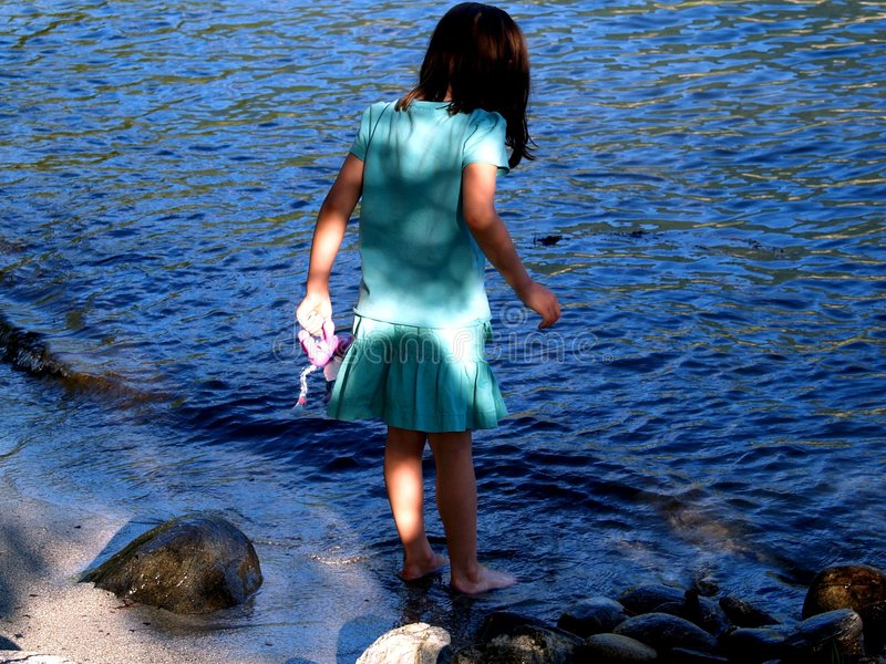 Child and water. Child would want to enter in too much cold water royalty free stock photography