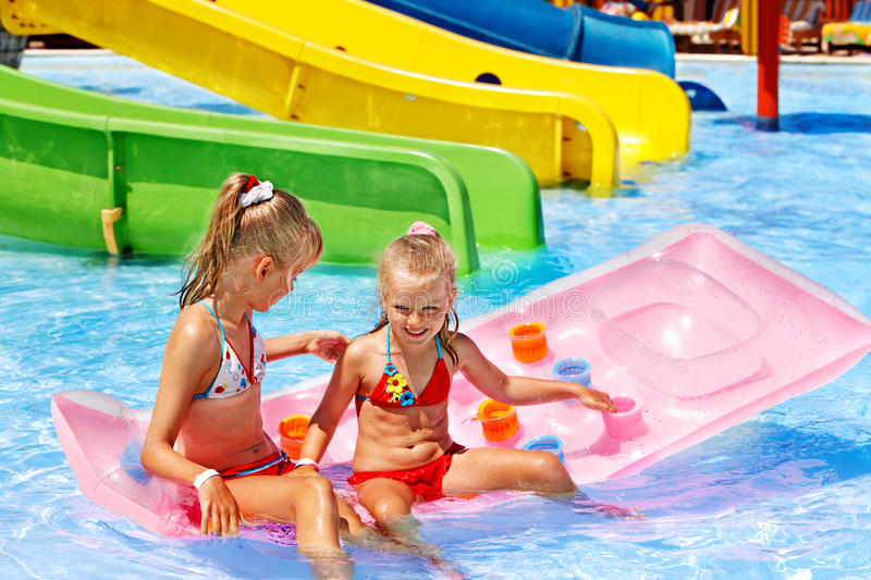 Download Child On Water Slide At Aquapark. Stock Photo - Image: 30021360