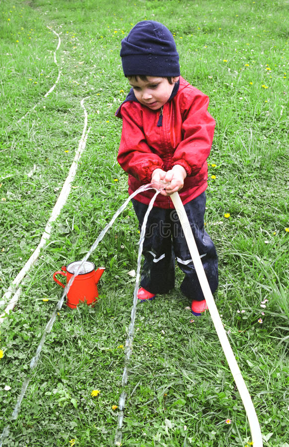 Download Child watering the garden stock image. Image of caucasian - 21753875
