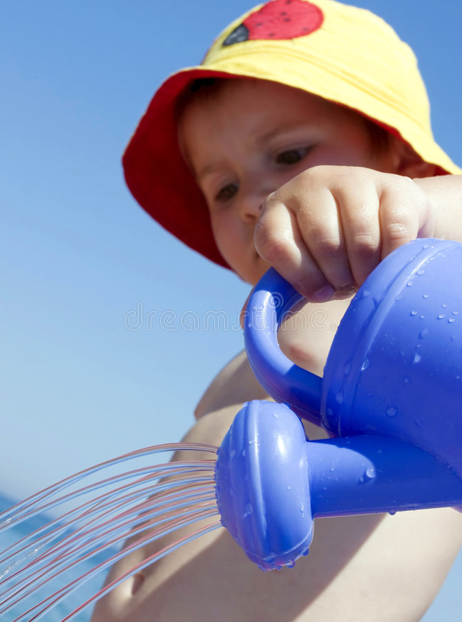 Download Child and watering-pot stock photo. Image of beautiful - 5693094